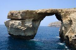 Arch in a rock by the sea Royalty Free Stock Images