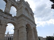 Arch of Roman amphitheater Arena Pula, Croatia, Europe. Arena Pula is one of four Ancient Roman amphitheaters still in use today. Built in the 1st Century AD royalty free stock photography
