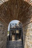 Through arch in a Roman fortress Dimum, Bulgaria. View through arch in a Roman fortress Dimum, Bulgaria Royalty Free Stock Photography