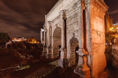 Arch of roman forum at the night Stock Photography