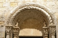Stone arch of church. Arch of the romanic church of Saint Vicent in Besalu,  a medieval town of Girona, Catalonia, Spain Royalty Free Stock Photo