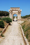 Arch of Septimius Severus. Road leading to the Arch of Septimius Severus in Leptis Magna, Libya Stock Image
