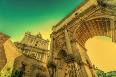 Arch of Septimius Severus and church of Santi Luca e Martina at Stock Photography