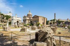 Arch of Septimius Severus and the Curia in Roman Forum, Rome. Rome, Italy - August 31, 2017: Arch of Septimius Severus and the Curia in Roman Forum, Rome Stock Image