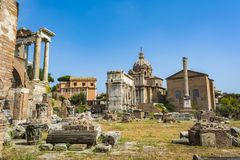 Arch of Septimius Severus and the Curia in Roman Forum, Rome. Rome, Italy - August 31, 2017: Arch of Septimius Severus and the Curia in Roman Forum, Rome Stock Images