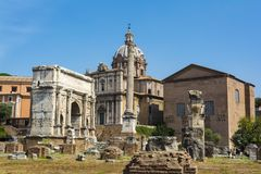Arch of Septimius Severus and the Curia in Roman Forum, Rome. Rome, Italy - August 31, 2017: Arch of Septimius Severus and the Curia in Roman Forum, Rome Royalty Free Stock Image