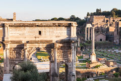 Arch of Septimius Severus and Forum of Caesar. Travel to Italy - Arch of Septimius Severus and Forum of Caesar on Roman Forums in Rome city Royalty Free Stock Photos
