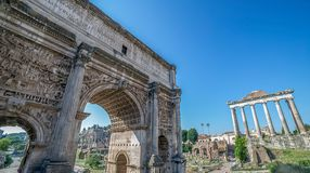 Arch of Septimius Severus inside the Roman Forum. Rome. Arch of Septimius Severus and aspects from inside the Roman Forum. Rome, Italy Royalty Free Stock Photography