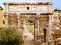 Arch of Septimius Severus, Roman Forum, Rome, Italy. The white marble Arch of Septimius Severus at the northwest end of the Roman Forum is a triumphal arch Royalty Free Stock Photos