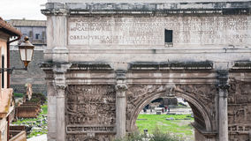 Arch of Septimius Severus in Roman Forum. Travel to Italy - marble Arch of Septimius Severus in Roman Forum in Rome city in winter Stock Photo