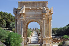 Arch of Septimius Severus. The arch of Septimius Severus at the Roman ruins of Leptis Magna on the Mediterranean coast of Libya stock photography