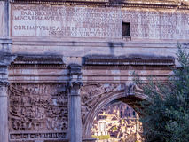 Arch of Septimius Severus, Rome. The Arch of Septimius Severus (Arco di Settimio Severo), a white marble arch in the Roman Forum. It is a triumphal arch to Stock Photography