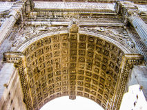 Arch of Septimius Severus. View from below of the Arch of Septimius Severus, in the Roman Forum (Foro Romano), the heart of ancient Rome Royalty Free Stock Photos