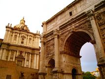 Arch of Septimius Severus. The white marble Arch of Septimius Severus at the northwest end of the Roman Forum is a triumphal arch dedicated in AD 203 to Royalty Free Stock Photography