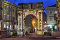 Arch of the Sergii in Pula-Golden door at evening. A wonderful example of ancient architecture located in Pula, Croatia Royalty Free Stock Photo