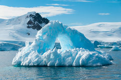 Arch shaped iceberg Antarctica Stock Images