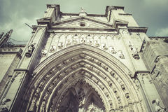 Arch and side door of the cathedral toledo Stock Photography