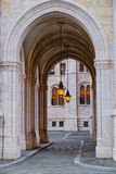 Arch at side of Parliament building in Budapest, Hungary. BUDAPEST, HUNGARY - JUNE 13, 2016: Arch at side of Parliament building in Budapest, Hungary, with two Royalty Free Stock Photography