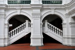 Arch, staircase, balustrade column. An artistically designed up and down white staircase with balustrade and columns by the kerbside Stock Photos