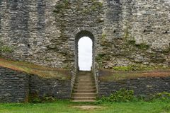 Arch with stairway in wall of of medieval castle. Arch with stairway in large brick wall of old medieval castle Royalty Free Stock Image