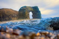 Arch of Steller. Massive stone arch. Arch of Steller in honor of zoologist Georg Steller. Massive stone arch on shore of Pacific ocean. Bering Island. Commander Stock Photography