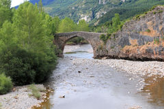 Arch stone bridge in romanesque Hecho village Stock Photography