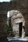 Arch of stone in Triora. An arch of stone in Triora in Liguria, a medioeval village historically associated with witches Royalty Free Stock Photo