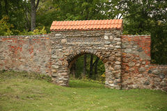 Arch in stone wall Stock Photo