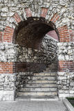 Arch in stone wall Stock Photos