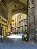 Arch and street in old city of Naples, Italy Royalty Free Stock Image