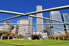 Arch structure of Chicago Millennium Park Pritzker Pavilion. City buildings and Pritzker Pavilion with featured steel frame in arch structure at Millennium Park Stock Photos