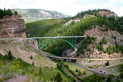 Arch Suspension Bridge. On Colorado highway 24.  The bridge located in the mountains goes over a canyon carved by the Eagle River just west of the town of Red Stock Photography