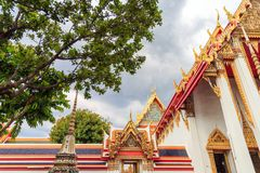 The arch and the temple and the tree. The beauty of architecture and nature at Wat Pho Bangkok Thailand Royalty Free Stock Images
