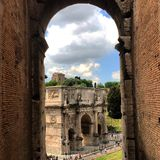 The Arch of Titus. Is located between the Roman Forum and the Coliseum . In this case, the photo was taken from inside the Coliseum in one of the arcades Royalty Free Stock Photos