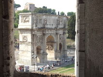 Arch of Titus in Rome. The Arch of Titus as seen from the Coliseum in Rome Italy Royalty Free Stock Images