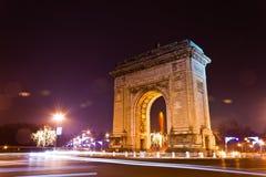 Arch Of Triumph. Arc De Triomphe in the night, Bucharest, Romania Stock Photos