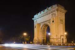 Arch of Triumph. Night view of the Arc de Triomphe located in Bucharest, Romania Stock Photo