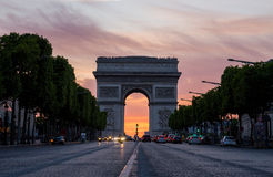 Arch of Triumph (Arc de Triomphe) with dramatic sunset Royalty Free Stock Photos