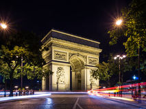 Arch of Triumph (Arc de Triomphe) at night with light trails Stock Photo