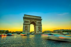 Sunset Arc de Triomphe. Arch of triumph. Arc de Triomphe at the western end of the Champs Elysees at the center of Place Charles de Gaulle in Paris at sunset Stock Image