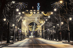 The Arch of Triumph Arcul de Triumf from Bucharest Romania. Christmas lights ornaments, view from Kisseleff Avenue Stock Image