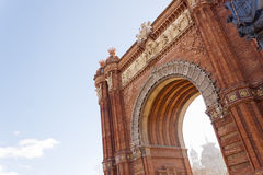 Arch of Triumph in Barcelona, Spain. The Arc de Triomf is a memorial or triumphal arch in Barcelona, Catalonia, Spain. It is built in reddish brickwork in the Royalty Free Stock Image