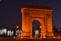 ARCH OF TRIUMPH, BUCHAREST. Arch of Triumph among Christmas lights Royalty Free Stock Photo