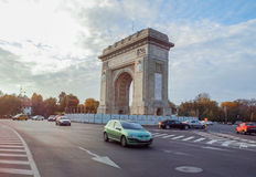 Arch of Triumph from Bucharest and traffic car on the street Royalty Free Stock Image