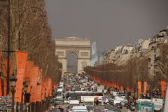 Arch of Triumph and Champs Elysees. Heavy traffic down the Champs Elysees and the Arch of Triumph Royalty Free Stock Photo