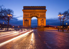 Arch of Triumph and Champs Elysees in Paris. Arc de triomphe Paris city at sunset Royalty Free Stock Image