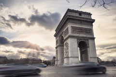 Arch of Triumph on the Champs Elysees in Paris, France. Arch of Triumph and cars on the Champs Elysees in Paris, France Royalty Free Stock Photography