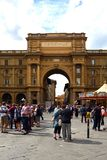 Arch of Triumph in Florence - Italy. Arch of Triumph on the Piazza della Repubblica in the historic center of Florence with peoples - Italy Royalty Free Stock Photography