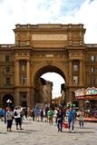 Arch of Triumph in Florence - Italy. Arch of Triumph on the Piazza della Repubblica in the historic center of Florence with peoples - Italy Royalty Free Stock Image