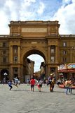Arch of Triumph in Florence - Italy. Arch of Triumph on the Piazza della Repubblica in the historic center of Florence with peoples - Italy Stock Photo